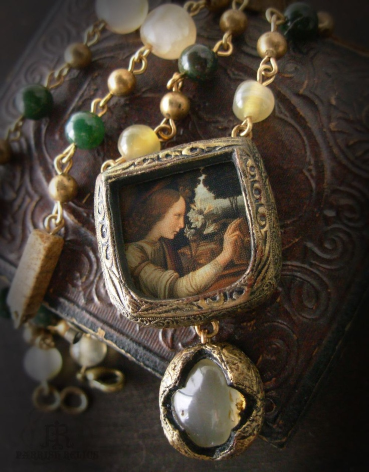 angel-and-lily-amulet-pendant